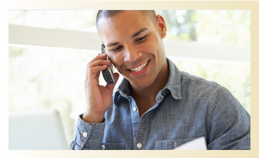 man getting a phone call and smiling