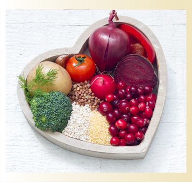 Heart shaped basket full of fruits and vegetables